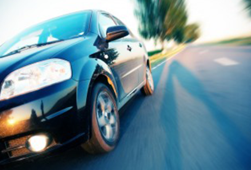 Car Speeding By on Road